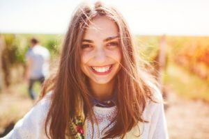 Smiling teenage girl outdoors